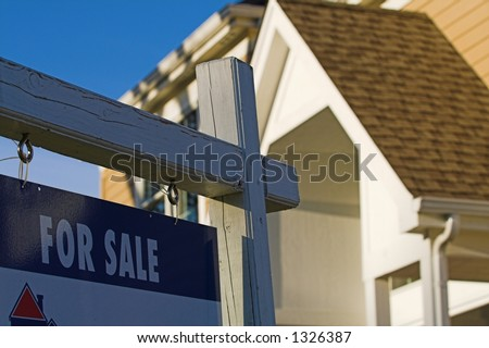 real estate for sale sign in front of house - stock photo