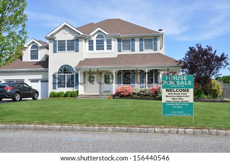 Real Estate For Sale Welcome Open House sign on suburban McMansion home in residential neighborhood USA - stock photo