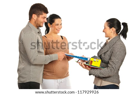 Real estate giving house contract to expectant couple isolated on white background - stock photo
