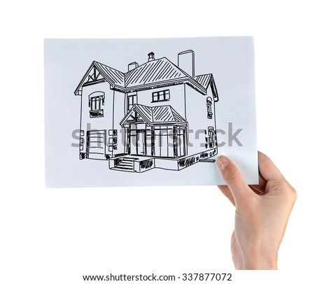 Real estate offer. Female hand holding the house picture - stock photo