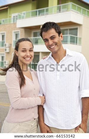 real estate: portrait of a couple in front of building