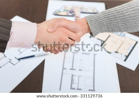 Real estate property deal handshake - stock photo