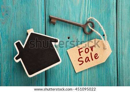 real estate sale concept - old key with tag - stock photo