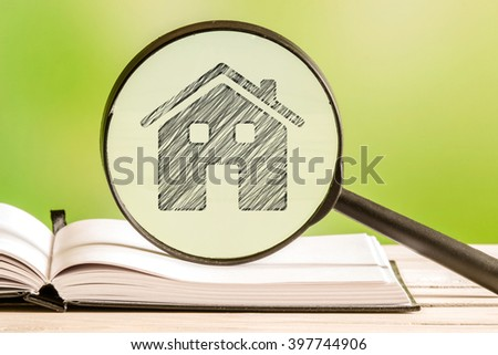 Real Estate search with a pencil drawing of a house in a magnifying glass - stock photo
