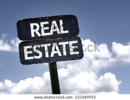 Real Estate sign with clouds and sky background - stock photo