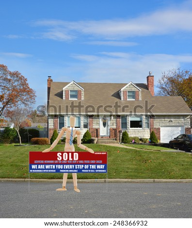 Real estate sold (another success let us help you buy sell your next home) sign Suburban Cape Cod home landscaped beautiful autumn day residential neighborhood USA - stock photo