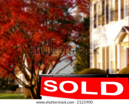 Real estate sold insert rider on Realtor lawn sign with white colonial style house for sale - stock photo