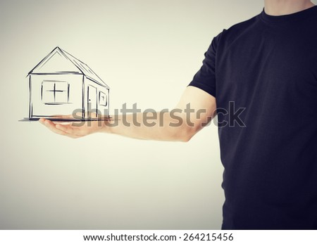 real estate, technology and accomodation concept - picture of house on virtual screen in man hand - stock photo