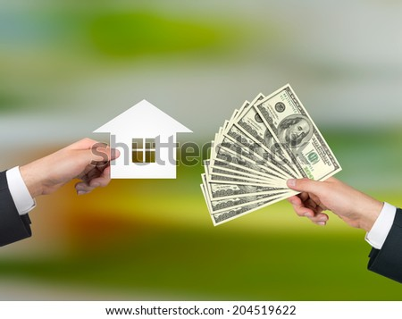 Real estate transaction. Cash and countryside house. - stock photo