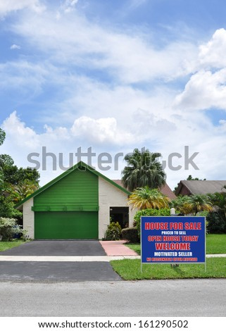 Real Estate Welcome Open House For Sale Sign front Yard lawn suburban back split style home with snout garage blacktop driveway sunny blue sky clouds residential neighborhood USA - stock photo