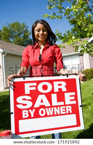 Real Estate: Woman Ready To Sell Home - stock photo