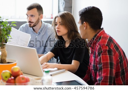 Real executives discussing new business plans, projects and strategies. Picture of busy business people working with documents in office. - stock photo
