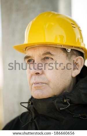 Real experienced builder ,selective focus on eye - stock photo