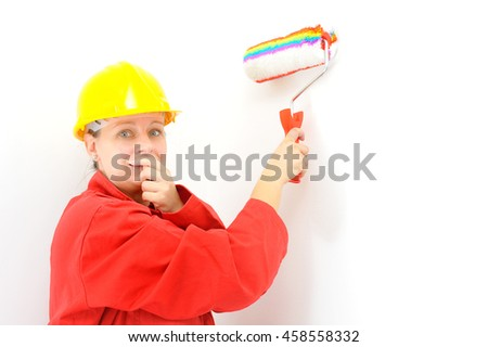 Real female painter painting wall, home renovation concept