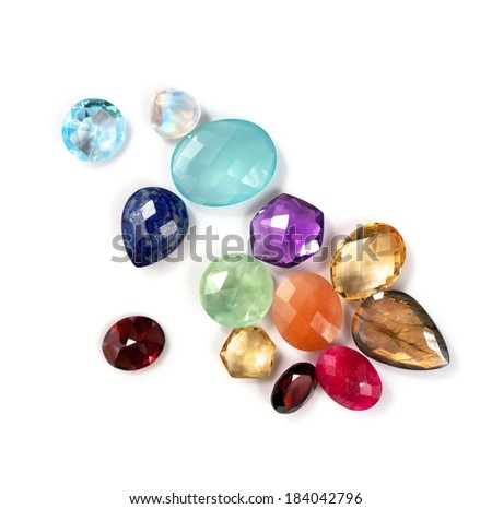 Real gemstones isolated on white background. Many natural colorful gems: amethyst, labradorite, aventurine, moonstone rainbow, blue topaz, ruby, lapis lazuli, prehnite, garnet, citrine and chalcedony. - stock photo