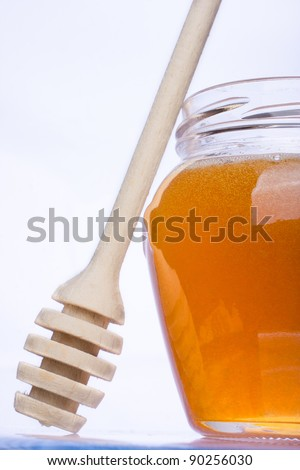 Real honey in a jar isolated on white - stock photo