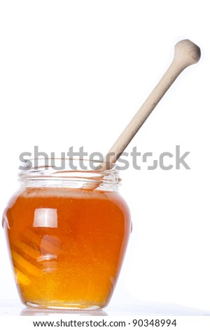 Real honey in a jar isolated on white. Artistic selective focus. - stock photo