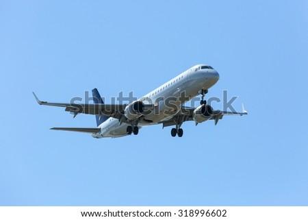 Real jet aircraft on sky - stock photo