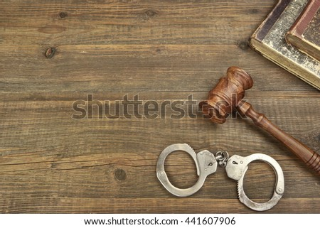 Real Judges Gavel, Handcuffs And Old Legal Book On The Grunge Wood Table In Courtroom, Top View, Copy Space - stock photo