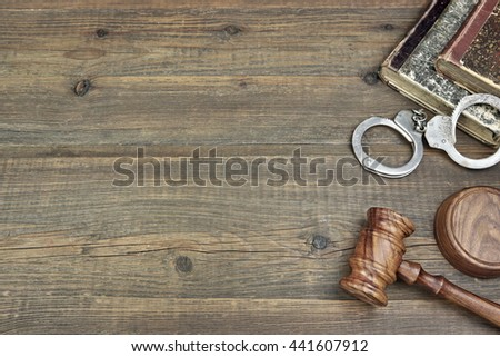 Real Judges Hammer, Handcuffs And Old Law Book On The Grunge Wood Table In Courtroom, Overhead View, Copy Space, Justice Concept - stock photo