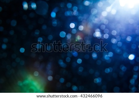 Real Lens Flare Shot in Studio over Black Background. Easy to add as Overlay or Screen Filter over Photos - stock photo
