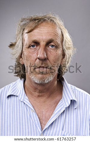 Real man in his 50's poses for a portrait