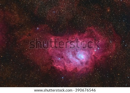 Real Nebula  called Lagoon Nebula or Messier 8 taken with CCD camera through medium focal length telescope - stock photo