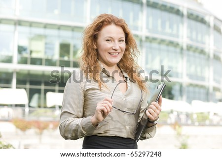 Real office worker posing for camera outdoor - stock photo
