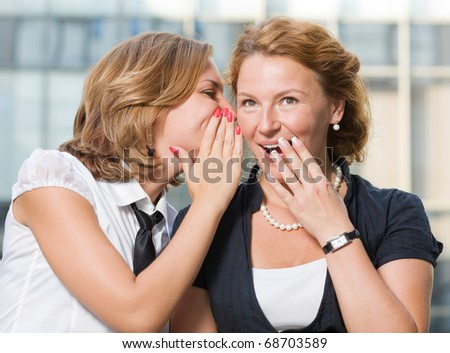 Real office workers discussing rumors - stock photo