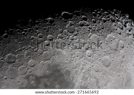 """real picture of the moon surface taken by telescope, focused in the twilight zone, called as well """"terminator of the moon"""" or """"grey line"""" - stock photo"""