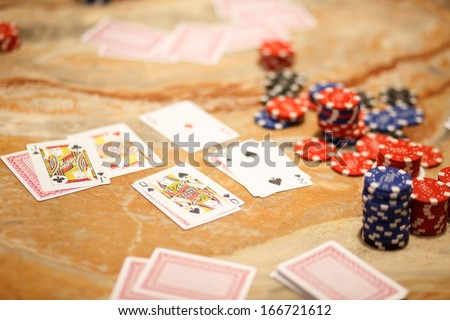 Real poker game between friends in the evening, not sterile super happy people - stock photo