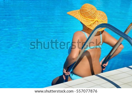 Real pregnant female beauty relaxing at swimming pool, summer vacation concept
