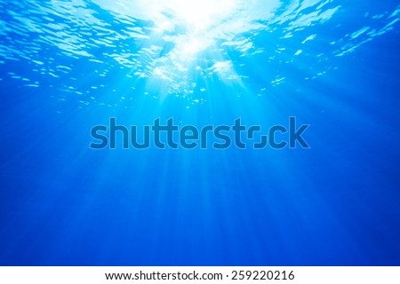 Real Ray of light from about 10 meters Underwater - stock photo