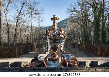 REAL SITIO DE SAN ILDEFONSO - JANUARY 4, 2015: Fountain of the Dragons, in the gardens of the Royal Palace of La Granja de San Ildefonso, Segovia, Spain, on January 4, 2015 - stock photo