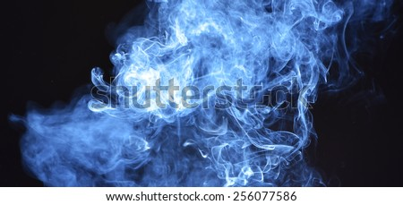 Real smoke wavy trail effects colored background - stock photo