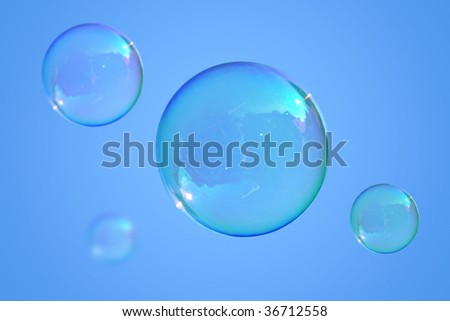 Real soap-bubbles on the blue sky - stock photo