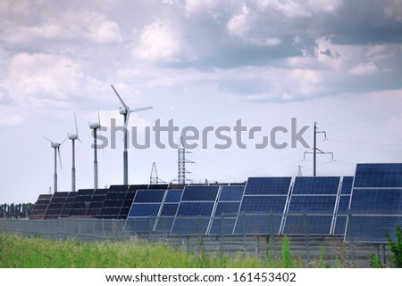 real solar panels and windmill