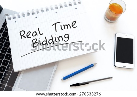 Real Time Bidding - handwritten text in a notebook on a desk - 3d render illustration. - stock photo