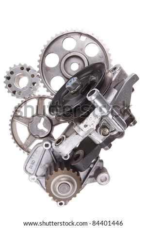 real used car water pump with several gears isolated over white background - stock photo