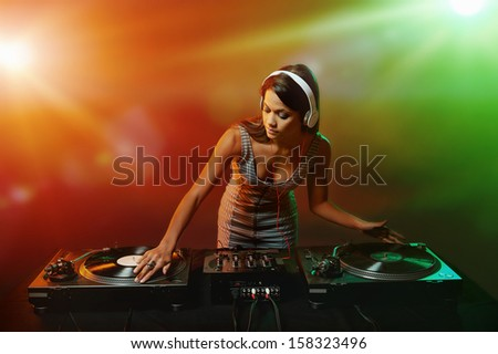 real woman dj playing music at party - stock photo