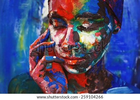 real woman painted upon her face imitating the oil painting - stock photo