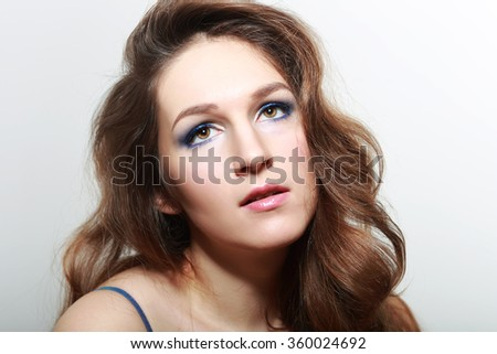 real woman with evening make-up studio portrait