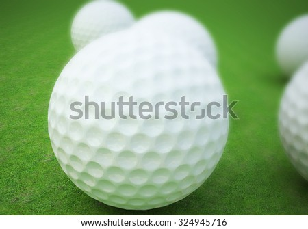Realistic golf balls on course . - stock photo