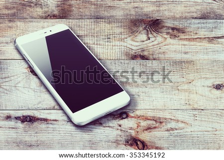 Realistic mobile phone iphon style mockup with black screen and shadows on wooden background. Highly detailed illustration. - stock photo