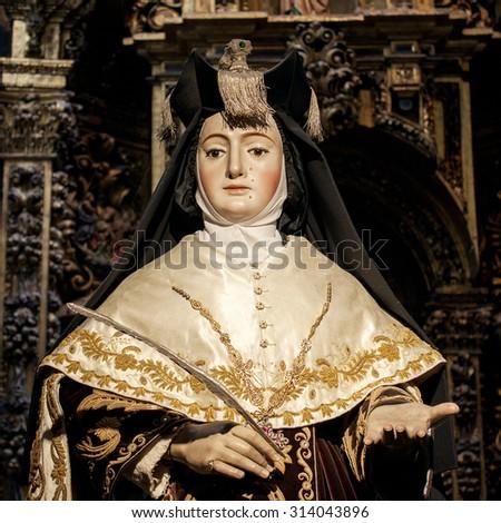 Realistic portrait of a female saint, Cathedral of Santiago de Compostela, Spain - stock photo