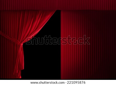 realistic stage curtains on a black background. Half curtain is still - stock photo