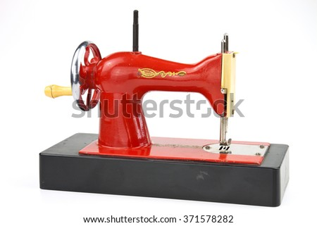 Realistically made sewing machine as a toy for practical training of children - stock photo
