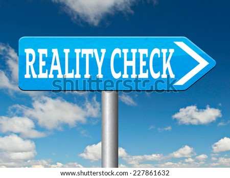 reality check up road sign for real life events and realistic goals down to earth  - stock photo