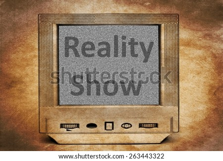 Reality show sign on TV - stock photo