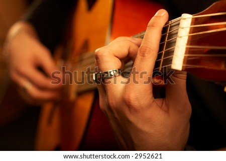 Really great shot capturing detail of a guitarist - shot in studio - stock photo